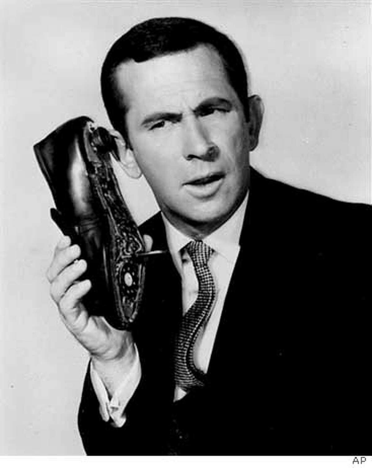 """In this undated file photo, Don Adams is seen in character as Maxwell Smart. Adams, the wry-voiced comedian who starred as the fumbling secret agent Maxwell Smart in the 1960s TV spoof of James Bond movies, """"Get Smart,"""" died of a lung infection late Sunday, Sept 25, 2005 in Los Angeles. He was 82. (AP Photo) Ran on: 09-27-2005 Ran on: 09-27-2005"""