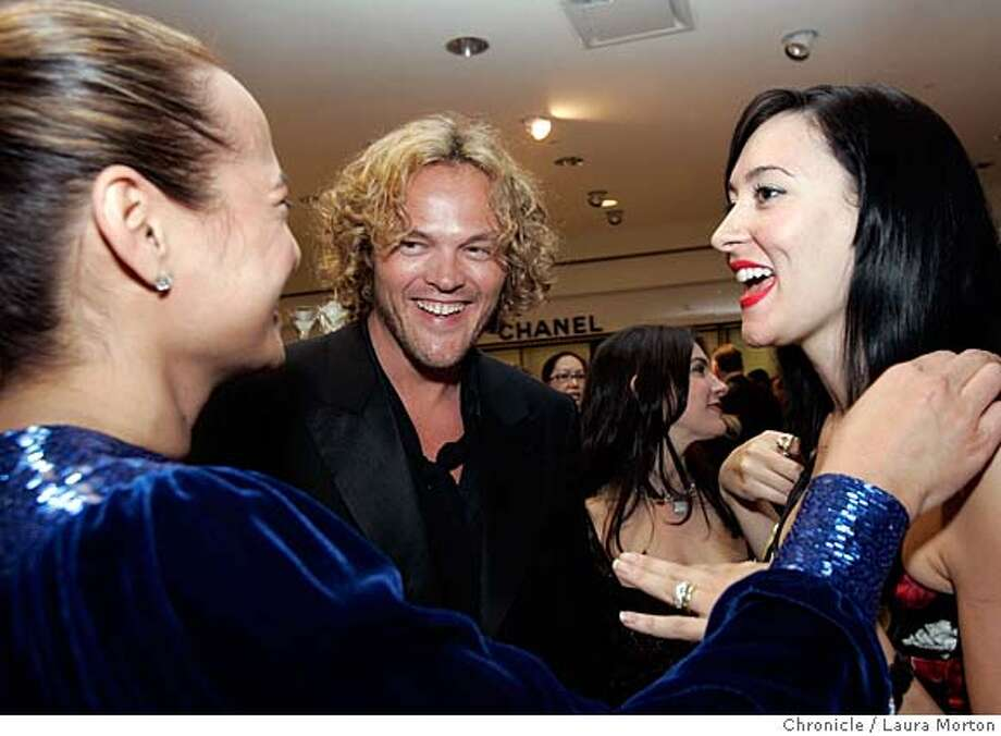 Peter Dundas (center), the new creative director for the French fashion label Emanuel Ungaro, chats with Gina Pell (left) and Amber Marie Bently (right) during a reception in his honor at Neiman Marcus in San Francisco, CA. (Laura Morton/Special to the Chronicle) *** Peter Dundas  *** Gina Pell *** Amber Marie Bently Photo: Laura Morton