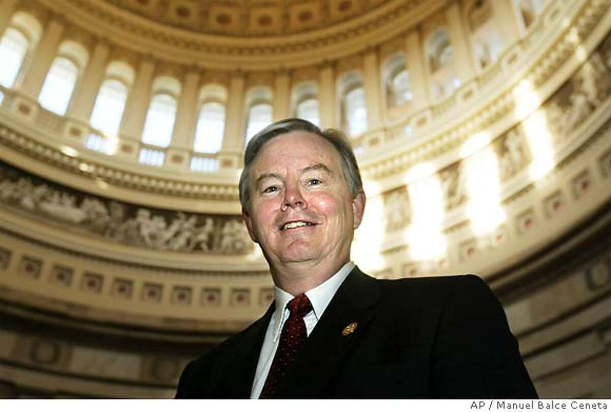 """** FILE ** In a file photo Rep. Joe Barton, R-Texas, poses at the Capitol Rotunda following a House Republican Steering Committee meeting on the Capitol Hill, Wednesday, Feb. 11, 2004, in Washington. Texas congressmen Joe Barton and Ralph Hall urged President Bush on Tuesday, June 28, 2005, to oppose a Chinese oil company's attempt to take over California-based Unocal Corp., arguing that """"this transaction poses a clear threat to the energy and national security of the United States."""" (AP Photo/Manuel Balce Ceneta) Ran on: 07-18-2005 Sherwood Boehlert FEB. 11, 2004, PHOTO"""