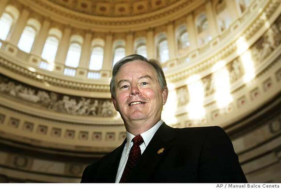 "** FILE ** In a file photo Rep. Joe Barton, R-Texas, poses at the Capitol Rotunda following a House Republican Steering Committee meeting on the Capitol Hill, Wednesday, Feb. 11, 2004, in Washington. Texas congressmen Joe Barton and Ralph Hall urged President Bush on Tuesday, June 28, 2005, to oppose a Chinese oil company's attempt to take over California-based Unocal Corp., arguing that ""this transaction poses a clear threat to the energy and national security of the United States."" (AP Photo/Manuel Balce Ceneta) Ran on: 07-18-2005  Sherwood Boehlert FEB. 11, 2004, PHOTO Photo: MANUEL BALCE CENETA"