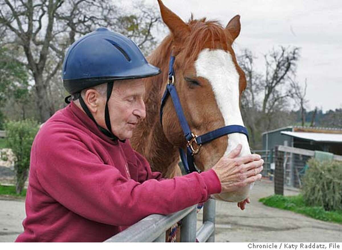 """HORSEMAN043_RAD.JPG SHOWN: Alan Manne has a quiet word with his horse """"Sharky"""" before beginning a riding lesson. Alan Manne began riding horses at age 60; he celebrated his 80th birthday in May 2005! His horse's name is """"Sharky."""" Alan rides at the Horse Park at Woodside. Photo taken on 2/25/05, in SAN FRANCISCO, CA. By Katy Raddatz / The San Francisco Chronicle MANDATORY CREDIT FOR PHOTOG AND SF CHRONICLE/ -MAGS OUT"""
