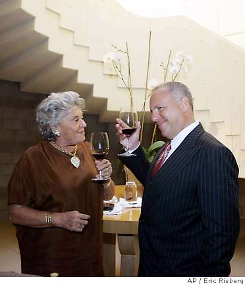 The Baroness Philippine de Rothschild of Chateau Mouton Rothschild in France, left, and Robert Sands, president and chief operating officer of Constellation Brands, Inc., toast each other during a luncheon after signing an accord at the Opus One winery in Oakville, Calif., Thursday Sept. 22, 2005. Prompted by Constellation�s acquisition of Robert Mondavi Winery in late 2004 and following several months of negotiations, Baron Philippe de Rothschild, S.A. and Constellation Brands, Inc. agreed to maintain 50-50 joint ownership of Opus One. Recognizing the winery�s increasing autonomy over the last three years, the agreement calls for operating independence for Opus One in three key areas: vineyard management, sales and marketing, and administration.(AP Photo/Eric Risberg) Photo: ERIC RISBERG
