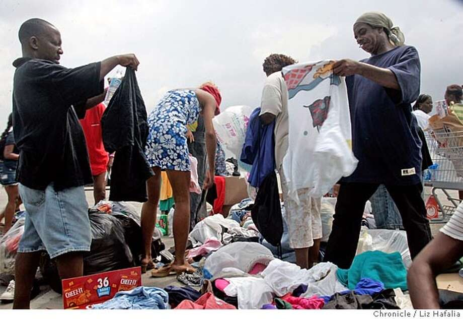 ASTRODOME_056_LH.JPG New Orleans residents being sheltered in the Houston Astrodome go through donations people have dropped off in the parking lot. Photographed by Liz Hafalia on 9/2/05 in Houston, Texas Ran on: 09-03-2005  New Orleans residents being sheltered in the Houston Astrodome go through donations people have dropped off in the parking lot. Creditted to the San Francisco Chronicle/Liz Hafalia Photo: Liz Hafalia