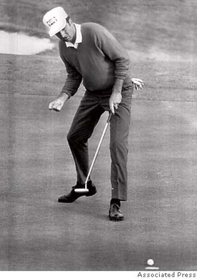George Archer's birdie putt at 18 is short, in final round of 1969 Masters. Archer one. Photo: Asdfadf
