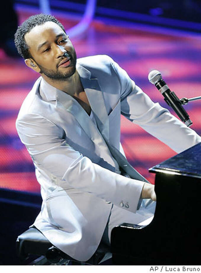 "American R&B singer John Legend performs during the ""Festival di Sanremo"" Italian songs contest, in San Remo, Italy, Wednesday, Feb. 28, 2007. (AP Photo/Luca Bruno) Photo: LUCA BRUNO"