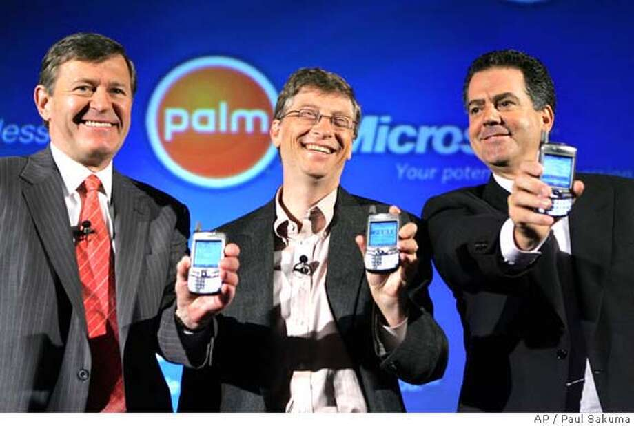 Microsoft Corp. chairman and chief software architect Bill Gates, center, Palm Inc. president and chief executive Ed Colligan, right, and Verizon Wireless chief executive Denny Strigl, left, smile as they hold up the new Palm Treo smartphone during a joint news conference, Monday, Sept. 26, 2005 in San Francisco. Palm announced that it has gone into business with former rival Microsoft Corp. to launch a Windows-based Treo smartphone, marking the first time that a Palm product will run on an operating system other than Palm's. (AP Photo/Paul Sakuma) Photo: PAUL SAKUMA