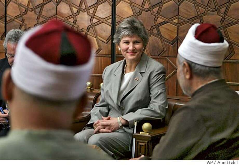 Karen Hughes, U.S. undersecretary of state for public diplomacy and public affairs, meets with Al Azhar Sheik Mohammed Sayyed Tantawi, right, the highest Islamic Sunni authority, in Cairo Egypt Sunday, Sept. 25, 2005. Hughes takes her first trip in her new job to counter negative attitudes about U.S. policies in the Middle East. (AP Photo/Amr Nabil) Photo: AMR NABIL