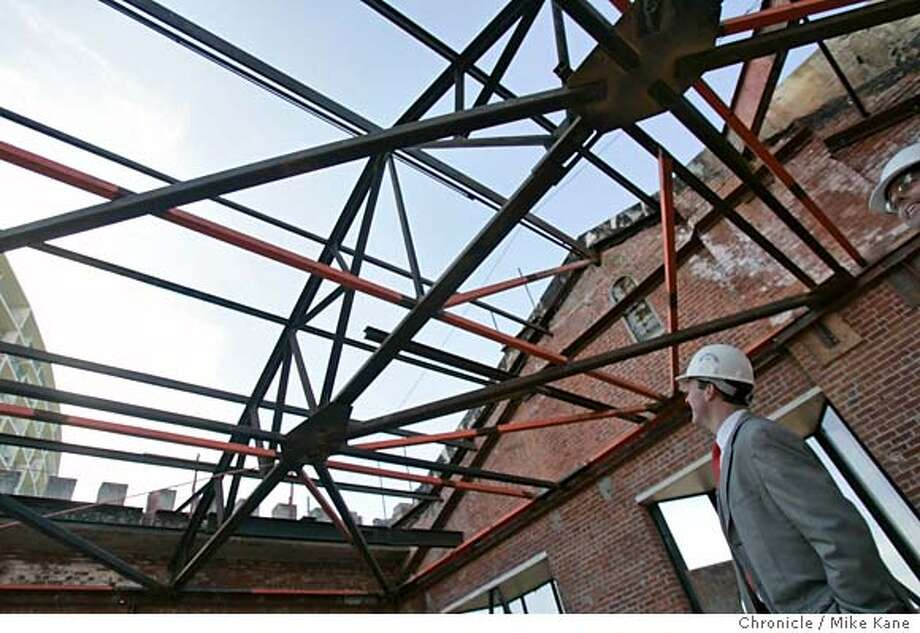 GHIRARDELLI_115_MBK.JPG  JMA Ventures partner Todd Chapman looks through the rafters of the old chocolate factory at Ghirardelli Square in San Francisco, CA, on Thursday, March, 22, 2007. JMA plans on converting the space into timeshare condos. photo taken: 3/22/07 Mike Kane / The Chronicle **Todd Chapman MANDATORY CREDIT FOR PHOTOG AND SF CHRONICLE/NO SALES-MAGS OUT Photo: MIKE KANE