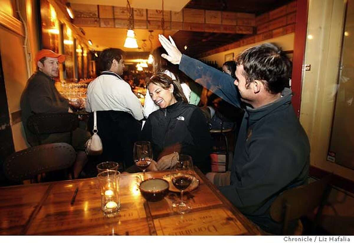 SPRINGBREAK30_096_LH_.JPG Angela Susnjara (middle), from Ohio, and Phil Hoover (right) from San Francisco, having Wellington Cabernet and a cheese platter at Marina Wine Merchant in San Francisco. Liz Hafalia/The Chronicle/San Francisco/3/17/07 **Angela Susnjara, Phil Hoover cq �2007, San Francisco Chronicle/ Liz Hafalia MANDATORY CREDIT FOR PHOTOG AND SAN FRANCISCO CHRONICLE. NO SALES- MAGS OUT.