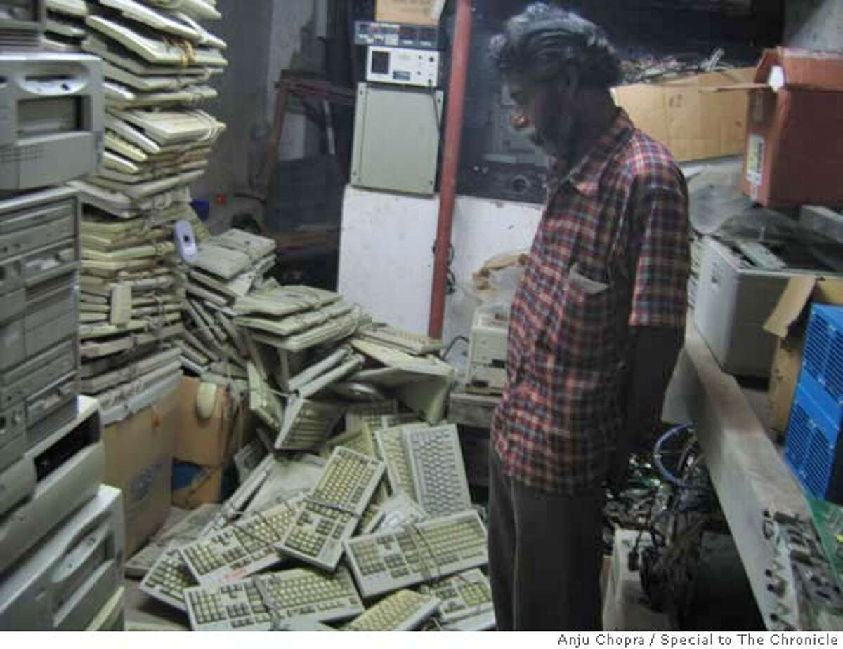 Photo of a worker handling e-waste at India's first e-waste crematorium, the Indian Computer Crematorium, also well known as Ash recyclers, in Bangalore. Photo by Anju Chopra/Special to The Chronicle Ran on: 03-30-2007 A worker in Bangalore handles unwanted electronic equipment at Indias first e-waste crematorium.