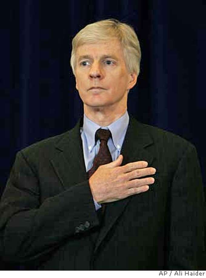 """The new U.S. Ambassador to Iraq, Ryan Crocker, stands during a swearing in ceremony at the US. Embassy in Baghdad, Thursday, March 29, 2007. Taking up where his predecessor, Zalmay Khalilzad, left off, the 57-year-old Crocker warned Prime Minister Nouri al-Maliki that his government """"must take all the necessary steps to unite the country. (AP Photo/Ali Haider, Pool) POOL Photo: ALI HAIDER"""