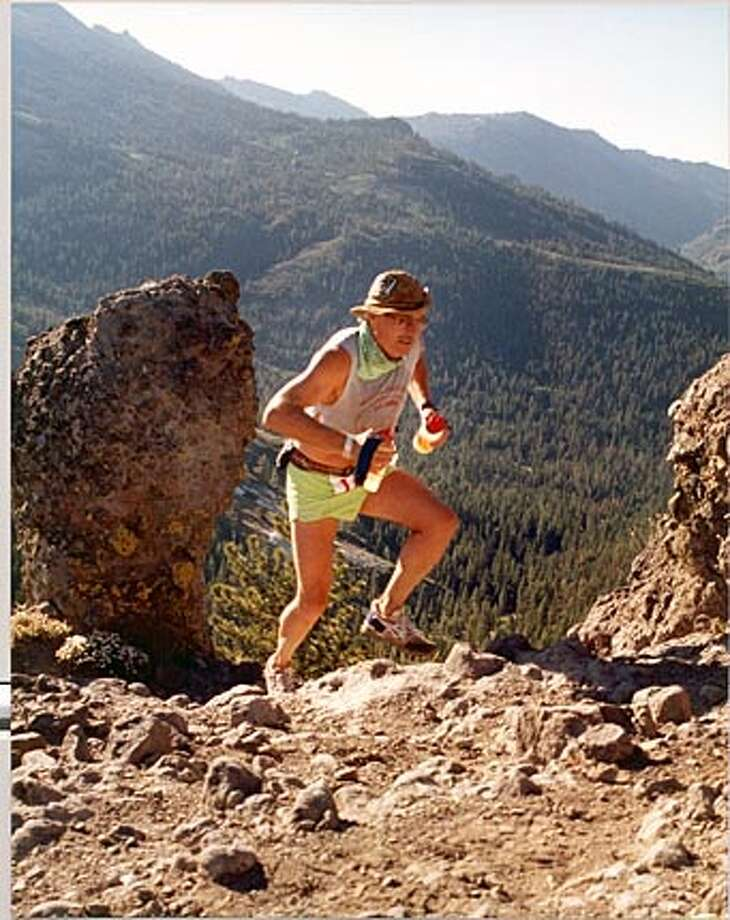 John Fazel takes part in the Western States 100 mile endurance run. The photo was taken at Cougar Rock high in the Sierras. on 9/20/05 in . / HO