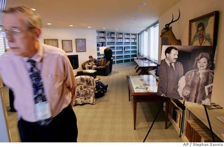 Allen Goodrich, archivist at the John Fitzgerald Kennedy Library, walks from the library's Ernest Hemingway Collection room in Boston, Thursday morning, March 29, 2007. The JFK Library released letters and telegrams written by Ernest Hemingway to Marlene Dietrich Thursday. One of the only photographs of Hemingway and Dietrich together is seen at right. (AP Photo/Stephan Savoia) Photo: Stephan Savoia