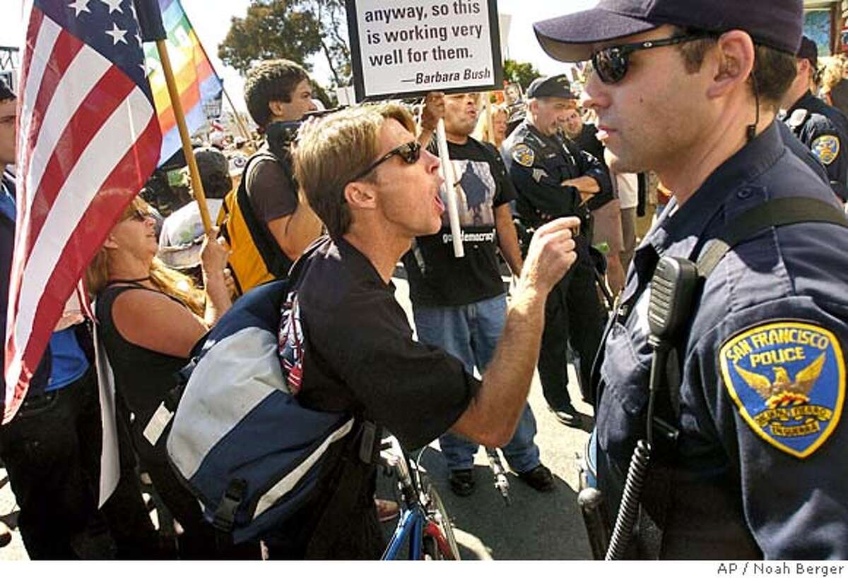 Anti-war demonstrator Barry Marchessault yells at a small group of picketers supporting President Bush during a peace march Saturday, Sept. 24, 2005, in San Francisco. (AP Photo/Noah Berger)