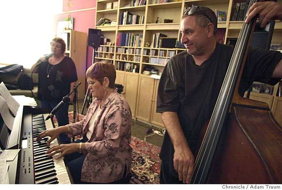 "Peter Barshay, right, Shanna Carlson, and Cathi Walkup rehearse for a house concert at the Bird's Nest. Once a month Cathy Walkup turns her Oakland house into The Bird's Nest, a venue where small jazz concerts take place. It is a trend of ""house concerts"" where emerging artists can perform and explore their music in an intimate setting. Adam Traum/The San Francisco Chronicle Photo: Adam Traum"