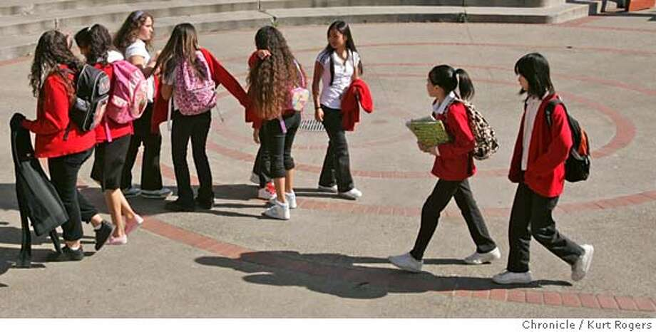Kids Martin Luther King Academic Middle School in the Bayview walk through the court yard between clases .  Kids at Martin Luther King Academic Middle School in the Bayview have a dress code and wear uniforms every day.  THURSDAY, MARCH 22, 2007 KURT ROGERS/THE CHRONICLE SAN FRANCISCO THE CHRONICLE  KURT ROGERS/THE CHRONICLE _P4A0013.JPG MANDATORY CREDIT FOR PHOTOG AND SF CHRONICLE / NO SALES-MAGS OUT Photo: KURT ROGERS/THE CHRONICLE