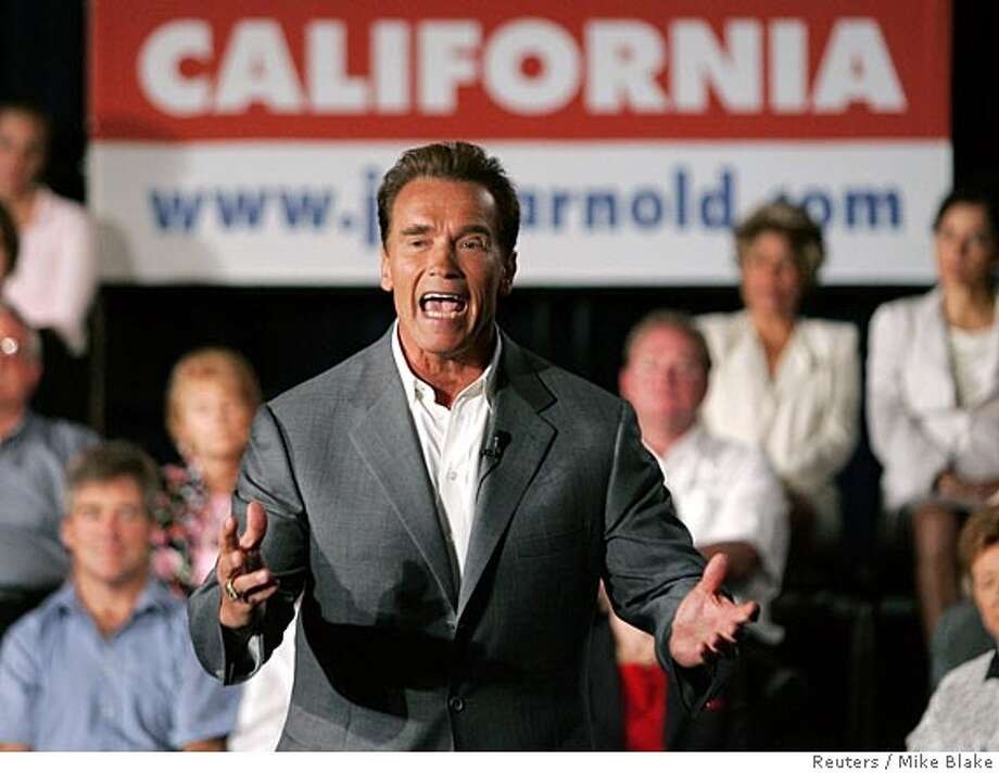 California Governor Arnold Schwarzenegger speaks during a town hall meeting, where he announced he would run for reelection in November 2006, in San Diego September 16, 2005. The movie star turned politician became governor after former governor Gray Davis lost a recall campaign to Schwarzenegger in 2003. REUTERS/Mike Blake 0 Photo: MIKE BLAKE