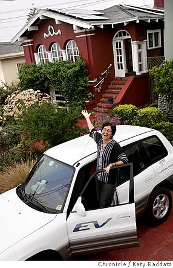 Story is about the Solar Homes Tour. SHOWN: Sherry Boschert, the president of the San Francisco Electric Vehicle Association, with her Toyota RAV4-EV (Electric Vehicle) in front of her home in the Inner Sunset neighborhood of San Francisco. One can see the solar panels on the roof of Sherry's home. Photo taken on 9/20/05, in San Francisco, CA.  By Katy Raddatz / The San Francisco Chronicle Photo: Katy Raddatz