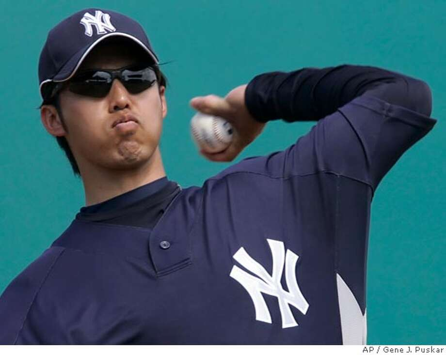 New York Yankees pitcher Kei Igawa, of Japan, throws a warm up pitch against the Pittsburgh Pirates in spring training baseball action at Bradenton, Fla., Saturday, March 10, 2007. (AP Photo/Gene J. Puskar) Photo: Gene J. Puskar