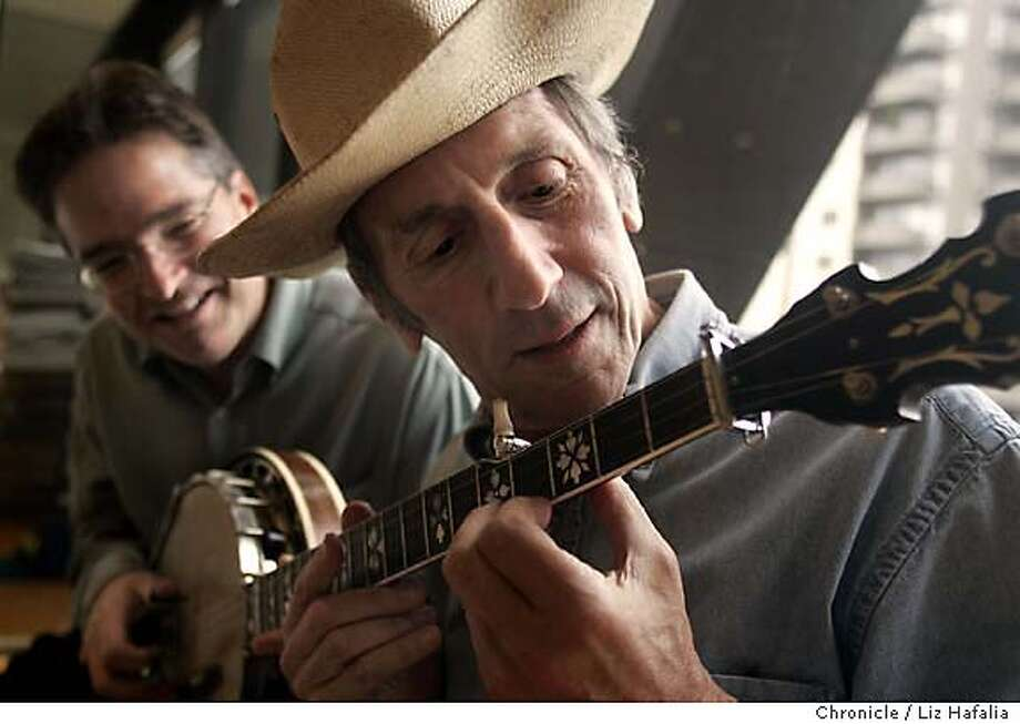 {file name} Hardly Strictly Bluegrass festival is founded by Warren Hellman (right) here with banjo musician Bill Evans, who lets Hellman play with his pre-World War II Gibson banjo. Photographed by Liz Hafalia on 9/13/05 in San Francisco, California. SFC Photo: Liz Hafalia