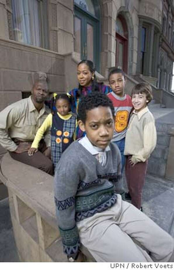 "** ADVANCE FOR MONDAY, SEPT. 5 **In this undated publicity photo released by UPN, the cast of the network's new , ""Everybody Hates Chris,"" pose on the show's set. Tyler Williams, who plays Chris sits in the foreground, with actors, from left,Terry Crews, Imani Hakim, Tichina Arnold, Tequan Richmond and Vincent Martella. (AP Photo/UPN, Robert Voets) ADVANCE FOR MONDAY, SEPT. 5. MANDATORY CREDIT; ; NO ARCHIVE; NORTH AMERICAN USE ONLY. 2005 CBS BROADCASTING INC. ALL RIGHTS RESERVED. Photo: ROBERT VOETS"