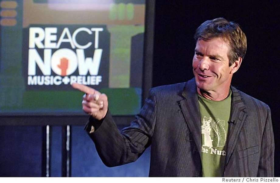 "Actor Dennis Quaid introduces Brian Wilson's performance during the ""ReAct Now: Music & Relief"" special at Paramount Studios in Los Angeles September 10, 2005. The show, which aired on MTV, CMT and VH1 channels, featured live and taped musical performances from a wide variety of artists across the country to raise funds for victims of Hurricane Katrina. REUTERS/Chris Pizzello 0 Photo: CHRIS PIZZELLO"