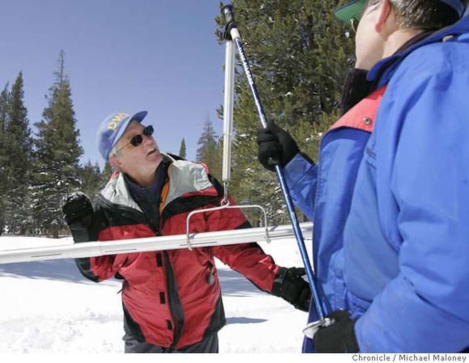 """Frank Gehrke (left) and Dave Hart of the state Department of Water Resources' Snow Survey weigh a sample of snow (in the tube) to measure it's moisture content.  At the Phillips Survey Station near Echo Summit, state officials today took their penultimate Sierra snow survey for the season, and the news was grim. The snow pack, an essential part of California's water supply, is far below normal, ranging from 55 percent of the average in the north to 40 percent in the south.  """"If things are about the same next year, we could be looking at tight times,"""" said Frank Gehrke, chief of the state Department of Water Resources' Snow Survey.  Photo by Michael Maloney / San Francisco Chronicle ***Frank Gehrke, Dave Hart MANDATORY CREDIT FOR PHOTOG AND SF CHRONICLE/NO SALES-MAGS OUT Photo: Michael Maloney"""
