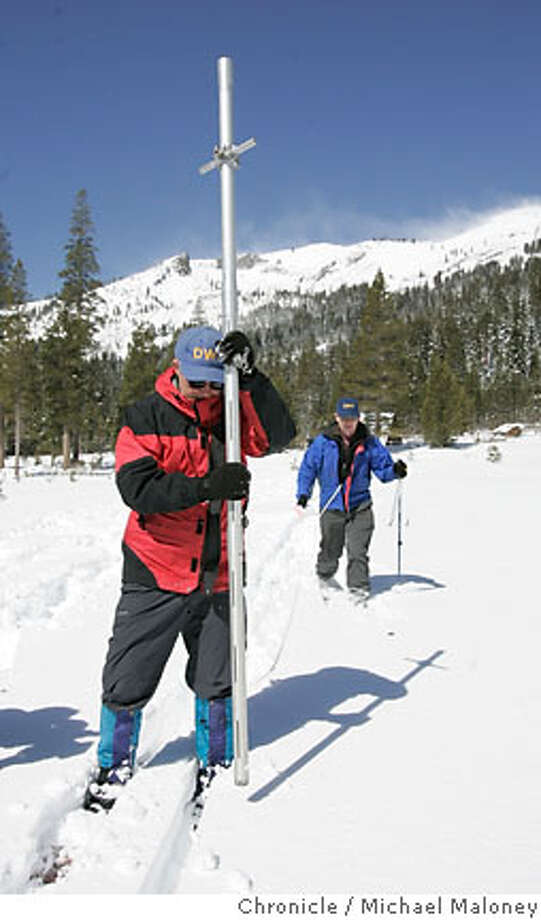 "Frank Gehrke of the state Department of Water Resources' Snow Survey (left) drives a hollow tube into the snow to measure snow depth and to take a sample. At right is Dave Hart also of the state Department of Water Resources' Snow Survey. At the Phillips Survey Station near Echo Summit, state officials today took their penultimate Sierra snow survey for the season, and the news was grim. The snow pack, an essential part of California's water supply, is far below normal, ranging from 55 percent of the average in the north to 40 percent in the south.  ""If things are about the same next year, we could be looking at tight times,"" said Frank Gehrke, chief of the state Department of Water Resources' Snow Survey.  Photo by Michael Maloney / San Francisco Chronicle ***Frank Gehrke, Dave Hart Photo: Michael Maloney"