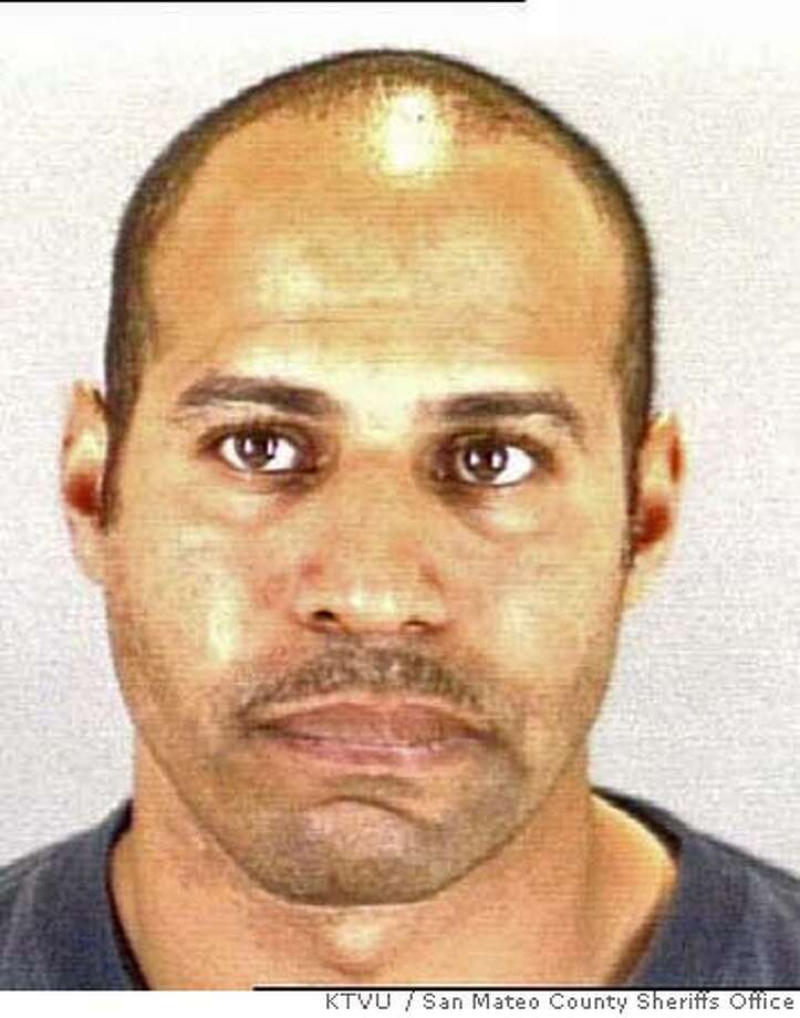 Booking mug of 33-year-old Marlon Ruff. Ruff fatally wounded 28-year-old police officer Bryan Tuvera on Friday night, December 22, 2006. San Mateo County Sheriffs Office/via KTVU  Ran on: 12-25-2006  Officer Craig Tom, Bryan Tuvera's field training officer, hugs another officer at Taraval Station.  Ran on: 12-25-2006  Officer Craig Tom, Bryan Tuvera's field training officer, hugs another officer at Taraval Station.  Ran on: 12-25-2006 Photo: San Mateo County Sheriffs Office