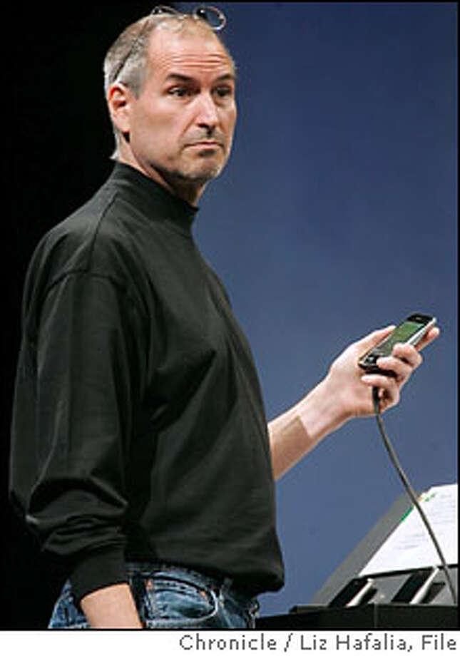 APPLE10_137_LH.JPG Steve Jobs introduces IPhone at the Apple MacWorld keynote address in Moscone West.  Photographed by Liz Hafalia  Ran on: 01-10-2007  Steve Jobs uses an iPhone during his speech at Macworld Expo.  Ran on: 03-25-2007  Steve Jobs, here using an iPhone, had options dated just before the iPod announcement. Photo: Liz Hafalia