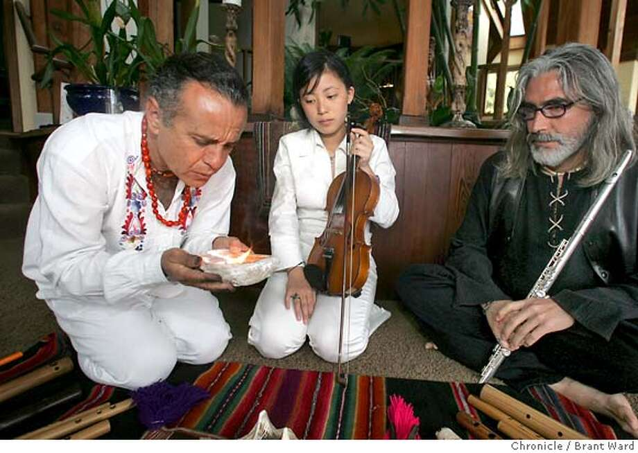 "larosa687_ward.jpg  Before performing music, Tito LaRosa, left, lights a fire and then lets the smoke drift over musicians Pauchi Sasaki, center, and flutist Tavo Castillo.  Tito LaRosa is a ""sound healer"" who has come to the Bay Area straight from the mountains of Peru. He will be doing several performances using unusual instruments locally before traveling north.  Brant Ward 9/20/05 Photo: Brant Ward"