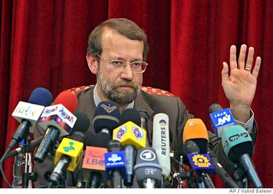 Iran's top nuclear negotiator Ali Larijani, gestures, as he speaks with media during a press conference in Tehran, Iran, Tuesday, Sept. 20, 2005. Larijani said the United States and Europe should learn lessons from the North Korean nuclear issue and recognize Iran's right to enrich uranium now rather than later.(AP Photo/Vahid Salemi) Photo: VAHID SALEMI