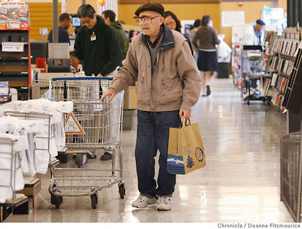 Yefim Berkhin (cq) uses a paper bag at Albertson's on Fulton at Masonic. An ordinance has been passed to outlaw plastic bags in large supermarkets in San Francisco in six months or so. Photographed in San Francisco on 3/28/07. Deanne Fitzmaurice / The Chronicle Yefim Berkhin Photo: Deanne Fitzmaurice