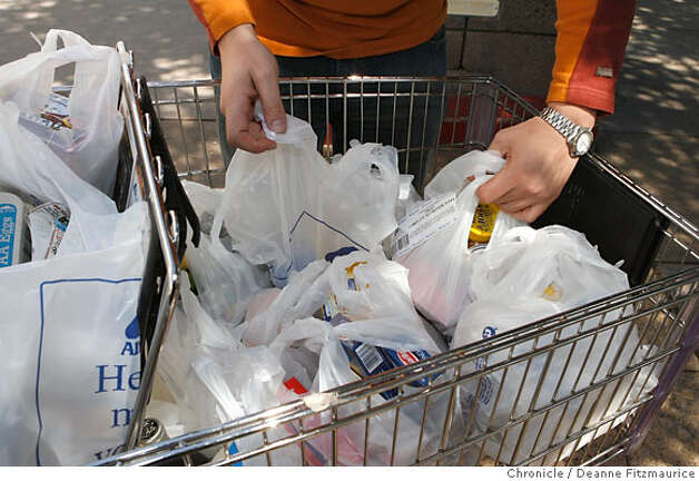 Some shoppers had a cartful of plastic bags for the groceries at Albertson's on Fulton at Masonic. An ordinance has been passed to outlaw plastic bags in large supermarkets in San Francisco in six months or so. Photographed in San Francisco on 3/28/07. Deanne Fitzmaurice / The Chronicle Photo: Deanne Fitzmaurice