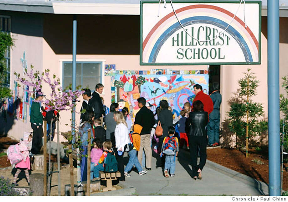 Parents drop off their children for a day of classes at Hillcrest School in Oakland, Calif. on Tuesday, March 27, 2007. Many prospective homeowners are willing to pay more for homes so their young children can enroll in schools with a high Academic Performance Index like Hillcrest, which boasts a rating of 951 out of a possible 1000.  PAUL CHINN/The Chronicle Photo: PAUL CHINN