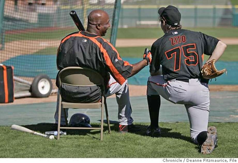 ***SPEAK WITH PHOTO BEFORE USING THIS. PART OF A LARGER PIECE ON ZITO*** giants_120_df.jpg  Barry Bonds jokes with Barry Zito after batting practice. Zito has signed with the San Francisco Giants as the highest paid pitcher in major league baseball. He is getting ready for the season during spring training at Scottsdale Stadium. Photographed in Scottsdale on 2/22/07. Deanne Fitzmaurice / The Chronicle Ran on: 03-25-2007  Barry Bonds said Barry Zito wanted to sit near him in the clubhouse to take advantage of all the extra locker space. Mandatory credit for photographer and San Francisco Chronicle. No Sales/Magazines out. Photo: Deanne Fitzmaurice