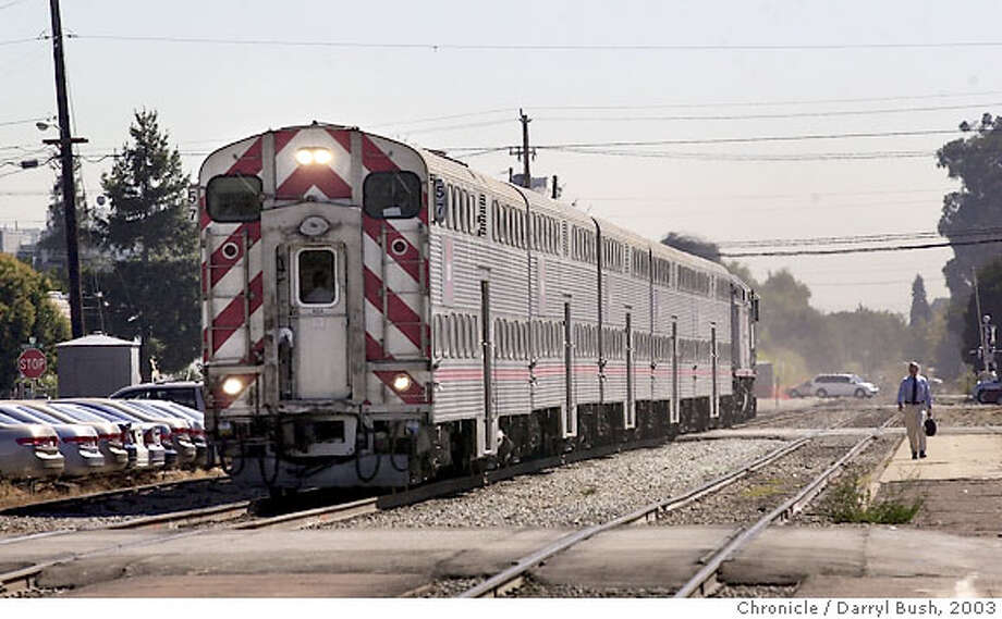 caltrain051_db.jpg  A northbound train arrives at Burlingame station. Caltrain changes fares and system of tickets to no buying onboard train. 9/19/03 in San Francisco.  DARRYL BUSH / The Chronicle Photo caption Here it goes here. Photo: DARRYL BUSH