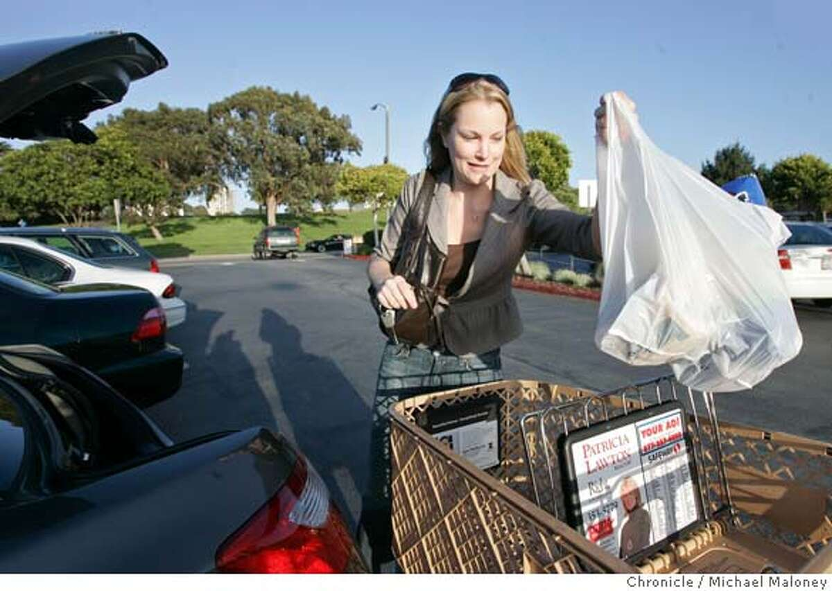 Robyn Hunter of San Francisco, loads plastic bags full of groceries into the trunk of her car after shopping at the Marina Safeway in San Francisco, CA. She said she will purchase re-useable canvas bags in the future. The San Francisco Board of Supervisors voted today, March 27, 2007 to ban plastic bags at groceries and pharmacies, making SF the first city in the nation to pass such a ban. Photo by Michael Maloney / San Francisco Chronicle ***Robyn Hunter MANDATORY CREDIT FOR PHOTOG AND SF CHRONICLE/NO SALES-MAGS OUT