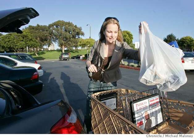 Robyn Hunter of San Francisco, loads plastic bags full of groceries into the trunk of her car after shopping at the Marina Safeway in San Francisco, CA. She said she will purchase re-useable canvas bags in the future.  The San Francisco Board of Supervisors voted today, March 27, 2007 to ban plastic bags at groceries and pharmacies, making SF the first city in the nation to pass such a ban.  Photo by Michael Maloney / San Francisco Chronicle ***Robyn Hunter MANDATORY CREDIT FOR PHOTOG AND SF CHRONICLE/NO SALES-MAGS OUT Photo: Michael Maloney