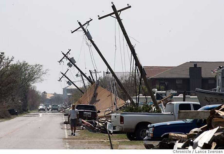 KATRINA21_0465.jpg_  Residents throughout areas affected by Hurricane Katrina in Louisiana are told to pile up their tree trimmings and damaged furniture curbside. This neighborhood in Slidell across Lake Pontchartrain from New Orleans is no exception. By Lance Iversen/San Francisco Chronicle Photo: Lance Iversen