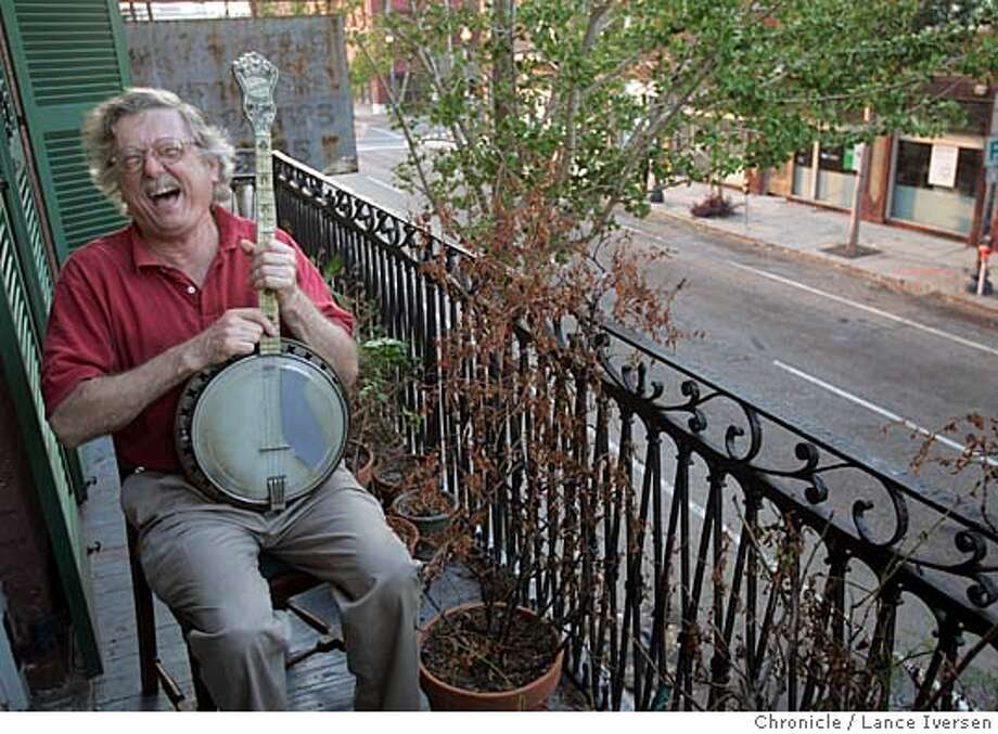 KATRINA210554.jpg_  George Schmidt plays his banjo on the balcony of his three-story home and business on Julia St waiting for clarification on the official evacuation notice regarding hurricane Rita. By Lance Iversen/San Francisco Chronicle MANDATORY CREDIT PHOTOG AND SAN FRANCISCO CHRONICLE. Photo: Lance Iversen