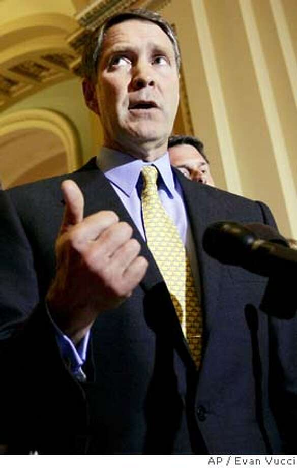 Senate Majority Leader Bill Frist, R-Tenn., right, gestures during a news conference about recovery and relief efforts for Hurricane Katrina on Tuesday, Sept. 20, 2005, in Washington. At left is Sen. Kay Bailey Hutchinson, R-Texas. (AP Photo/Evan Vucci) Photo: EVAN VUCCI