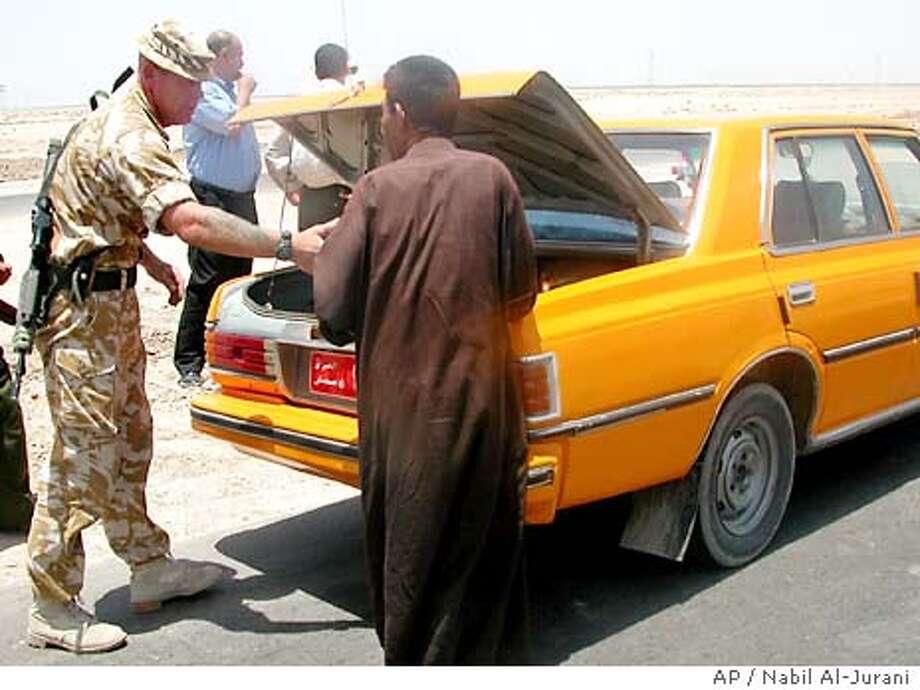 6/25/2003 | B/W | 5star | 46p4x5.25inch | A18 | A-Section | Warren, x6169 | IRAQ Photo: NABIL AL-JURANI