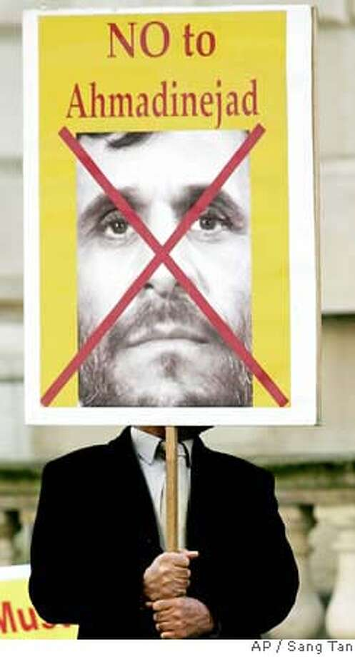 A supporter of the National Council of Resistance of Iran, stands with a placard outside the Foreign and Commonwealth Office in London, during a demonstration calling on Britain to stand firm against Tehran, and to accept the ruling of the European Court of Justice to remove People's Mujahdeen Organisation of Iran from the European Union terror list, Tuesday, March 27, 2007. Iran is currently holding 15 British sailors and marines, seized while patrolling the Shatt al Arab waterway on the Iraq-Iran border.(AP Photo/Sang Tan) Photo: SANG TAN