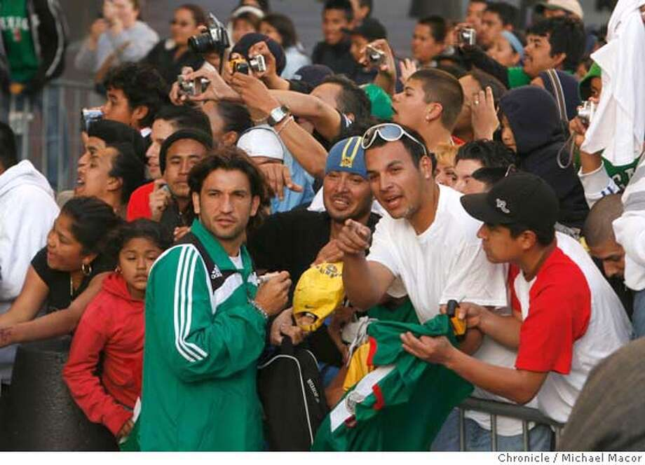 soccerfans_097_mac.jpg Francesco Fonseca greets fans on the way to practice. Soccer fans gather at the Marriott Hotel in downtown Oakland to see the players of the Mexico's National team who will play Ecuador's National team tomorrow night in Oakland. Photographed in, Oakland, Ca, on 3/27/07. Photo by: Michael Macor/ The Chronicle Mandatory credit for Photographer and San Francisco Chronicle No sales/ Magazines Out Photo: Michael Macor