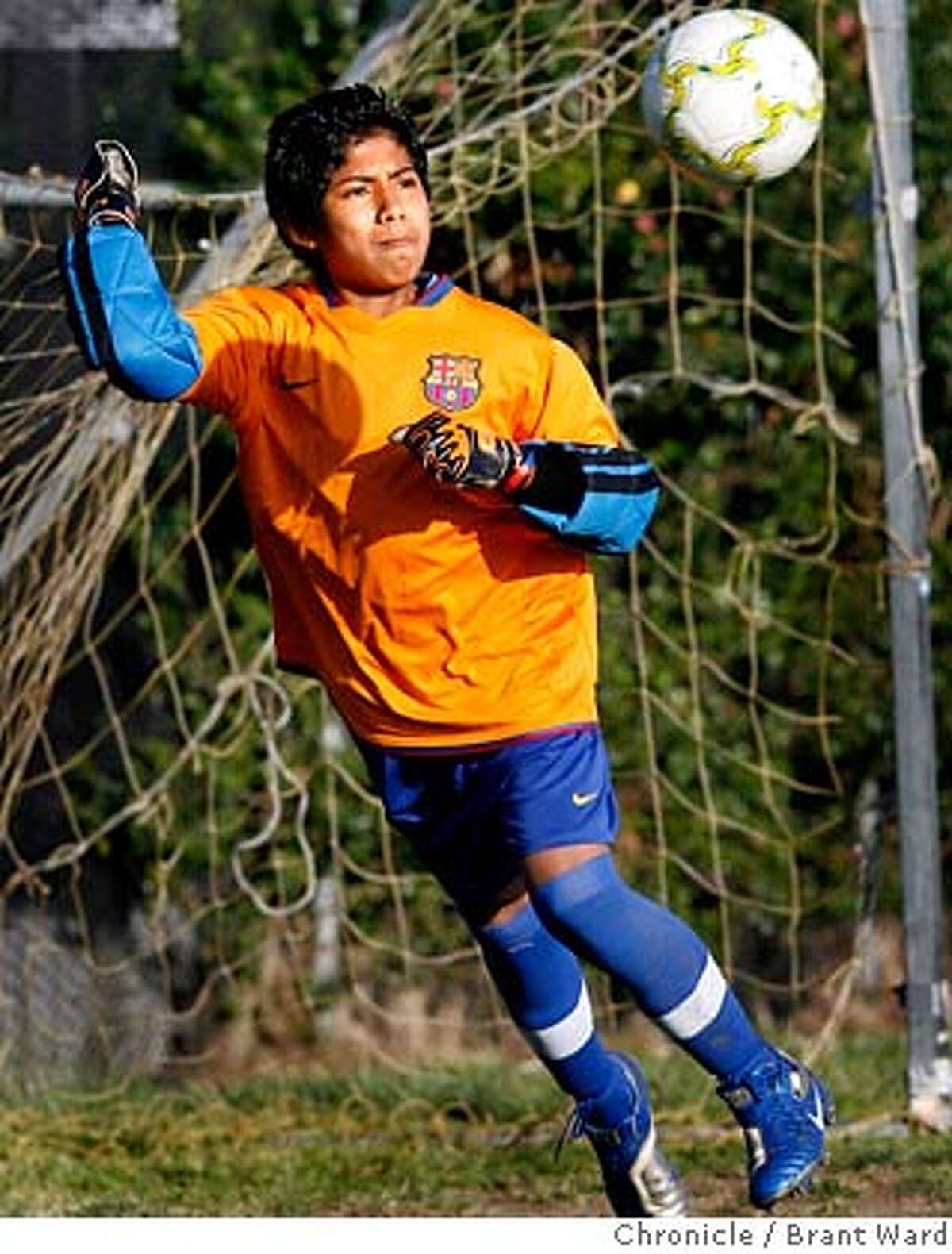 13 year old Francisco Mendoza plays goalie for his youth soccer team. He gets to go to the match Wednesday where he will root for his beloved Mexican Nationals. The Mexican National team has come to town for a match against Ecuador. Many will have to watch the game on television but a few lucky fans will get to attend the game Wednesday night. Youth soccer teams were practicing at Lazear Field Tuesday night...everyone was looking forward to the game. {Brant Ward/San Francisco Chronicle}3/27/07