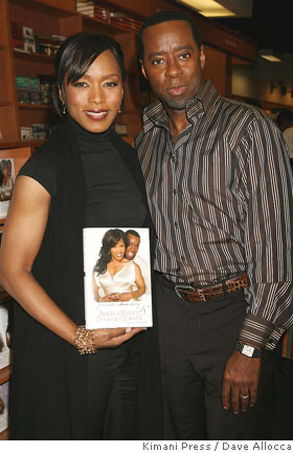 "In this photo released by Kimani Press, actors Angela Bassett and Courtney B. Vance appear in a New York City book store to sign copies of their book: ""Friends: A Love Story,"" Thursday, March 1, 2007. (AP Photo/Kimani Press, Dave Allocca) **NO SALES** PHOTO PROVIDED BY KIMANI PRESS; NO SALES Photo: DAVE ALLOCCA"