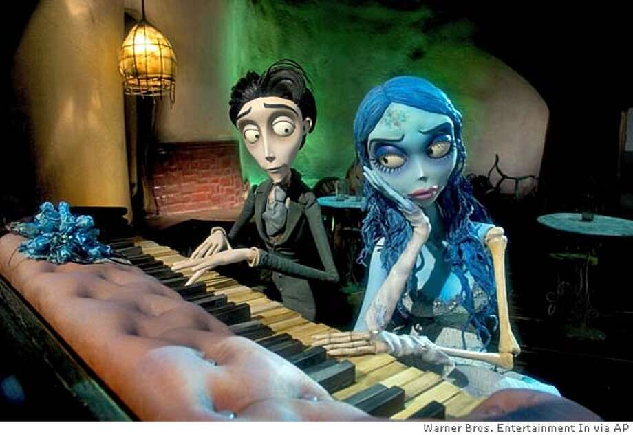Victor Van Dort, left, voiced by Johnny Depp, and the Corpse Bride, voiced by Helena Bonham Carter,are shown in a scene from Warner Bros. Pictures stop-motion animated fantasy Tim Burtons Corpse Bride. (AP Photo/Warner Bros. Entertainment In.) MAGS OUT, PHOTOGRAPHS Photo: Warner Bros. Entertainment In