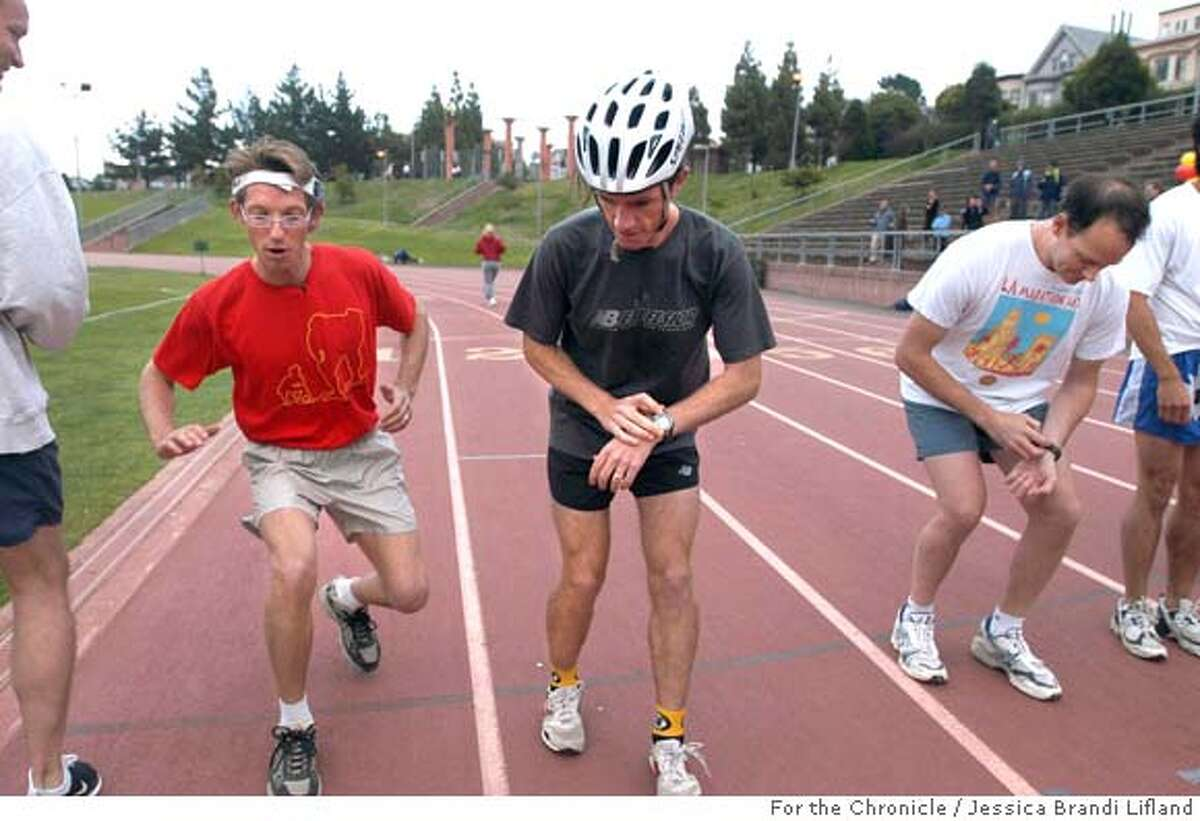 Joshua Davis, of San Francisco, second from left, at the starting line as he attempted to break the world record for the backwards mile on Tuesday evening at Kezar Stadium. He called upon his friends and anyone else who would be interested to join in the backwards run. From left are W.O.