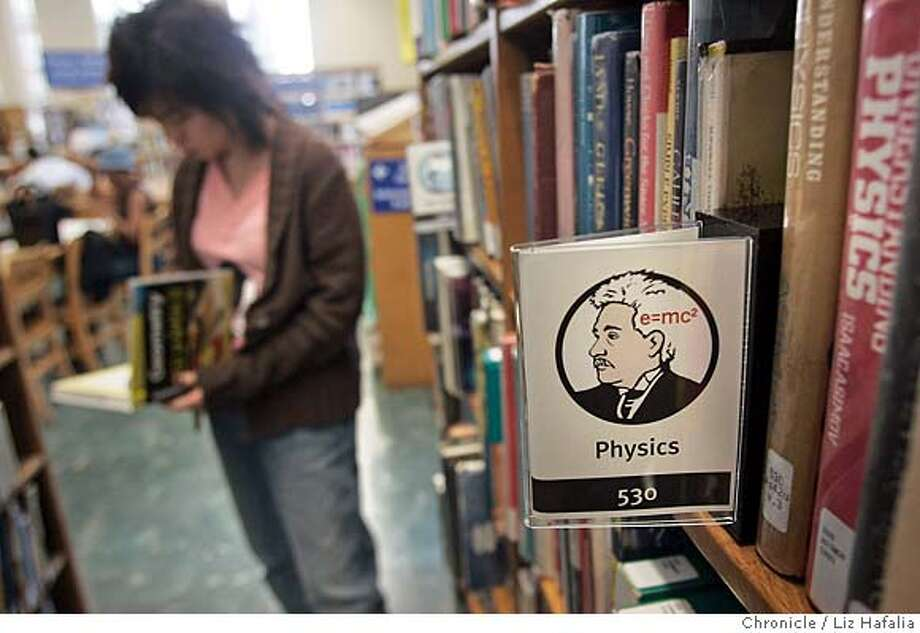 EBLPICTOGRAM_066_LH.JPG In first of its kind project, the Oakland public library has installed unique pictograms, or little graphic signs, to help people w/ learning disabilities to find books in the library. Many learning disabled people have trouble using the Dewey Decimal System used in most libraries. Photographed by Liz Hafalia on 8/24/05 in Oakland, CA Photo: Liz Hafalia